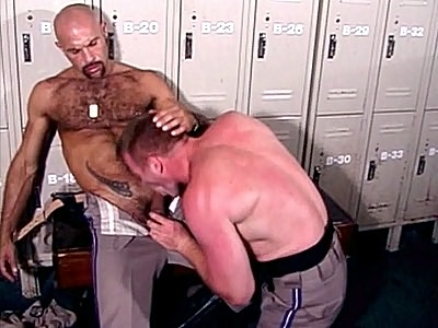 Two tough looking gay bear cops were at a locker room, taking off their sweaty clothes and getting ready to take a shower. In this scene they eye out each other and hit it off and soon they\'re making out and taking turns swallowing each others big cock.video