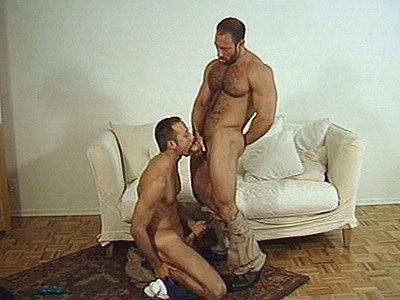 When hairy gay Eric Evans sees muscle bound daddy Thomas Bond stroking his dick in his living room, this horny gay bear reacted by helping him out and sucking his cock. They switched position and then went deeper by taking turns pounding each other\'s asshole.video